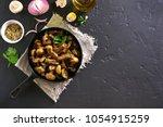 beef stroganoff with mushrooms... | Shutterstock . vector #1054915259