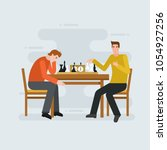 two young men playing chess  ...   Shutterstock .eps vector #1054927256