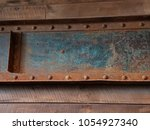 green and red rusted metal with ... | Shutterstock . vector #1054927340