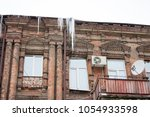 building covered with big... | Shutterstock . vector #1054933598
