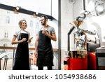 couple of baristas talking... | Shutterstock . vector #1054938686