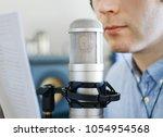 man recording an advertisement... | Shutterstock . vector #1054954568