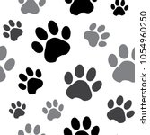 Stock vector seamless pattern with black and gray silhouette animal paw track isolated on white background 1054960250