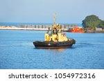 tugboat in harbor quayside of...   Shutterstock . vector #1054972316