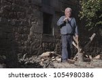 older man with old clothes ... | Shutterstock . vector #1054980386