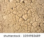 cracked soil ground   desert... | Shutterstock . vector #1054983689