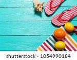 flip flops on blue wooden...   Shutterstock . vector #1054990184