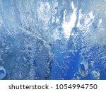textured ice blue frozen rink... | Shutterstock . vector #1054994750