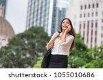 asian business woman talking on ... | Shutterstock . vector #1055010686