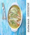 baked salmon topped bechamel... | Shutterstock . vector #1055020769