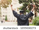 young woman on her graduation... | Shutterstock . vector #1055030273