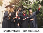 a group of multietnic students... | Shutterstock . vector #1055030366