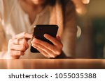 hand of woman using smartphone... | Shutterstock . vector #1055035388
