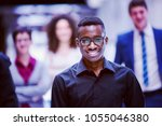 young multi ethnic business... | Shutterstock . vector #1055046380