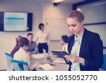 yonug blonde businesswoman in ... | Shutterstock . vector #1055052770