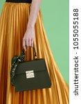 model holds fashion handbag | Shutterstock . vector #1055055188