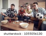 group of friends watching... | Shutterstock . vector #1055056130