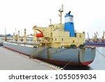 bulk carrier ship in port of... | Shutterstock . vector #1055059034