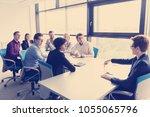 business team meeting in modern ... | Shutterstock . vector #1055065796