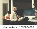 happy young business man ... | Shutterstock . vector #1055066336