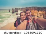 handsome couple backpackers... | Shutterstock . vector #1055091110