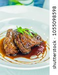 beef meat filet mignon with red ... | Shutterstock . vector #1055098598