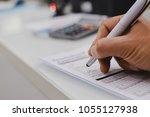 closeup of hand writing filling ... | Shutterstock . vector #1055127938