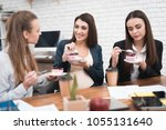three young cute girls eating...   Shutterstock . vector #1055131640