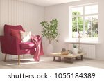idea of white room with sofa... | Shutterstock . vector #1055184389