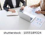 business team meeting working... | Shutterstock . vector #1055189324