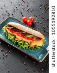 fresh sandwiches with ham ... | Shutterstock . vector #1055192810