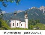 the lake chapel  heilig kreuz...   Shutterstock . vector #1055206436