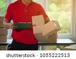 handsome deliver male in red... | Shutterstock . vector #1055222513