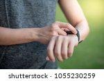 male hand pressing button menu... | Shutterstock . vector #1055230259