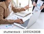 business team meeting present ... | Shutterstock . vector #1055242838