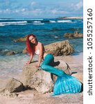 mermaid girl with red hair and... | Shutterstock . vector #1055257160
