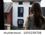 young female traveller staying... | Shutterstock . vector #1055258708