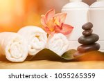 spa background. white towels on ... | Shutterstock . vector #1055265359