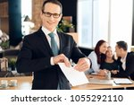 joyful family lawyer in suit... | Shutterstock . vector #1055292110