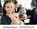 happy little girl is hugging... | Shutterstock . vector #1055292173