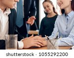 adult man looks at wedding ring ... | Shutterstock . vector #1055292200