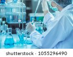 laboratory scientist working at ... | Shutterstock . vector #1055296490