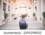 beautiful asia woman traveler... | Shutterstock . vector #1055298020