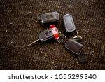 ignition keys on floor | Shutterstock . vector #1055299340