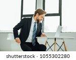 smiling elegant man with beard...   Shutterstock . vector #1055302280