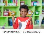 african american ethnicity kid... | Shutterstock . vector #1055303579