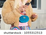 milan   february 21  woman with ...   Shutterstock . vector #1055312513