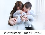 cheerful  young parents with... | Shutterstock . vector #1055327960