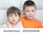 children sitting on coach  two... | Shutterstock . vector #1055333648