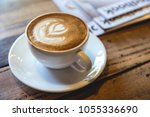 a cup of coffee with heart... | Shutterstock . vector #1055336690
